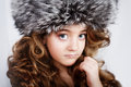 Young girl in fur cap portrait of a beautiful Royalty Free Stock Photography