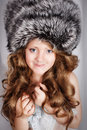 Young girl in fur cap portrait of a beautiful Royalty Free Stock Image