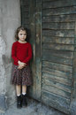 Young girl in gate with sad face, little bit fear, Royalty Free Stock Photos