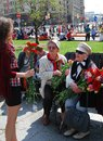 Young girl gives flowers to war veterans victory day celebration on may in moscow Royalty Free Stock Images