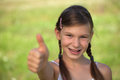 Young girl giving thumbs up Royalty Free Stock Photo