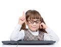 Young girl with glasses and keyboard showing finger up. isolated Royalty Free Stock Photo