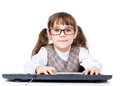 Young girl with glasses typing keyboard. isolated on white Royalty Free Stock Photo