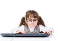 Young girl with glasses typing on keyboard. isolated on white Royalty Free Stock Photo