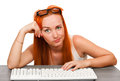 Young girl with glasses typing keyboard Royalty Free Stock Photo