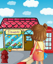 A young girl going to the flowershop illustration of Stock Image