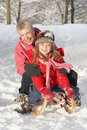 Young Girl With Grandmother Riding On Sledge Stock Photos