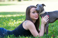 Young girl with greyhound attractive laying on the grass Royalty Free Stock Photo