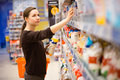 A young girl in a grocery supermarket beautiful woman shopping for cereal bulk Royalty Free Stock Photos