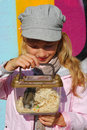 Young girl  with hamster in portable transporter Royalty Free Stock Photography