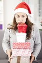 Young girl has a lot of christmas gifts Royalty Free Stock Photo