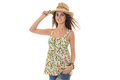 Young girl in a hat and beautiful summer t-shirt stands up straight and looking at camera isolated on white background Royalty Free Stock Photo