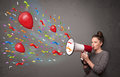 Young girl having fun shouting into megaphone with balloons and confetti Stock Photos