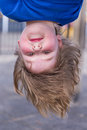 Young girl head hanging upside down Royalty Free Stock Photo