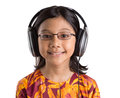 Young girl with headphone ii asian listening to over white background Stock Photo