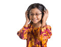 Young girl with headphone iii asian listening to over white background Stock Photo