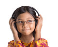 Young girl with headphone iv asian listening to over white background Stock Photos