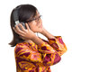 Young girl with headphone ix asian listening to over white background Stock Image