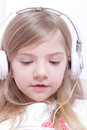 Young girl with headphones Royalty Free Stock Photography