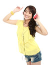 Young girl with headphones listening music and dancing Stock Images