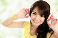 Young girl with headphones portrait listening music used Royalty Free Stock Image