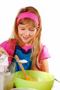 Young girl helping in baking cake Stock Photo