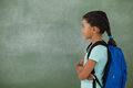 Young girl with her arms crossed against chalk board Royalty Free Stock Photo