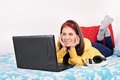 Young girl in her room looking something on her laptop this is really interesting Royalty Free Stock Image