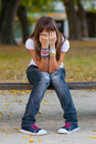 Young girl hides her face with hands Royalty Free Stock Photography