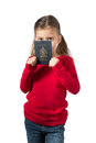 Young Girl Hiding her Face Behind Canadian Passport Royalty Free Stock Photo