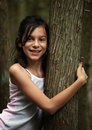 Young girl hiking in the woods Stock Images