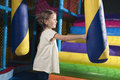 Young girl hitting foam object in play gym Royalty Free Stock Photos