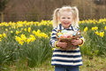 Young Girl Holding Basket Of Decorated Eggs Royalty Free Stock Photography