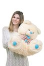 Young girl holding big teddy bear in soft toy isolated on white Royalty Free Stock Photos