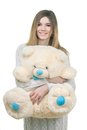 Young girl holding big teddy bear in soft toy isolated on white Stock Image