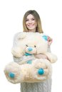 Young girl holding big teddy bear in soft toy isolated on white Royalty Free Stock Images