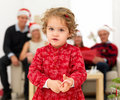 Young girl holding candy cane at christmas Stock Photo