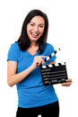 Young girl holding clapperboard cheerful asian female over white Stock Photos