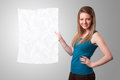 Young girl holding crumpled white paper copy space