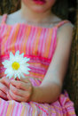 Young girl holding daisy Royalty Free Stock Images