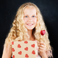 Young Girl Holding Gift Box and Red Heart. Cute Teenager Royalty Free Stock Photo