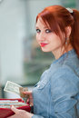 Young girl holding a money wallet with and credit card Royalty Free Stock Image