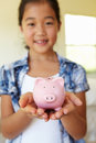 Young girl holding piggybank Royalty Free Stock Photo