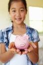 Young girl holding piggybank Royalty Free Stock Photo