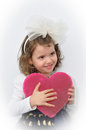 Young girl holding a plush pink heart Royalty Free Stock Photo