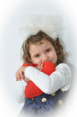 Young girl holding a pulsh red heart Royalty Free Stock Photo