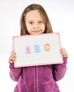 Young girl holding sign with ABC Royalty Free Stock Photo