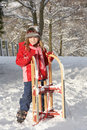 Young Girl Holding Sledge In Snowy Landscape Royalty Free Stock Image