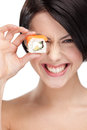 Young girl holding sushi and smiling Stock Image