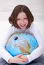 Young girl hugging earth globe Royalty Free Stock Photo